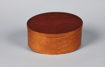 "Maple, red cedar and white pine oval box made at Mount Lebanon, with view of inscription on underside of lid header: ""Frederick W. Evans 1857"". Shaker Museum 