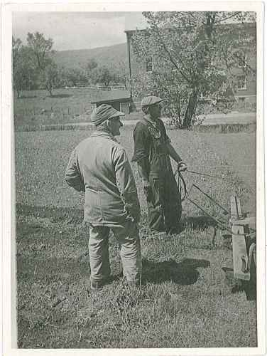 Brother Curtis White with a hired man in the kitchen garden