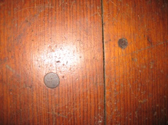Meetinghouse Floor Comparing the Two Different Sizes of Pegs Found Arranged in Lines, Church Family, Mount Lebanon, NY, ca. 2011. Museum staff  photograph.