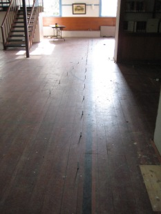 Meetinghouse Floor with Markers Erected to Show Position of Aligned Pegs on the South End of the Sanctuary, Church Family, Mount Lebanon, NY, ca. 2011. Museum staff  photograph.