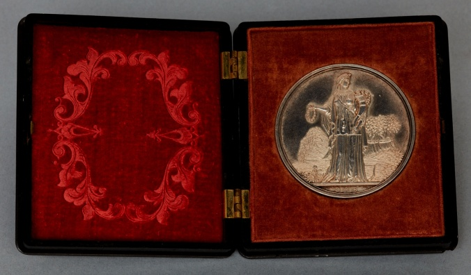 SilverAward Medal (front inguttaperchacase), New York State Agricultural Society to the Shaker Sisters