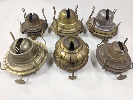 Wick holders,ca. 1844 - 1950, Canterbury, NH,Shaker Museum | Mount Lebanon:row 1: 2018.7.1,1950.3700.2,2018.7.2; row 2:1962.13779.2,1950.3699.2, 1950.3701.2.Staff photograph.